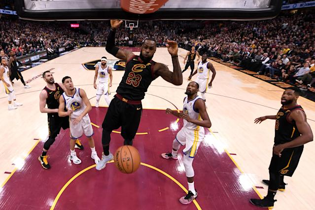 LeBron James throws down a dunk against the Warriors on Wednesday night. (Getty)