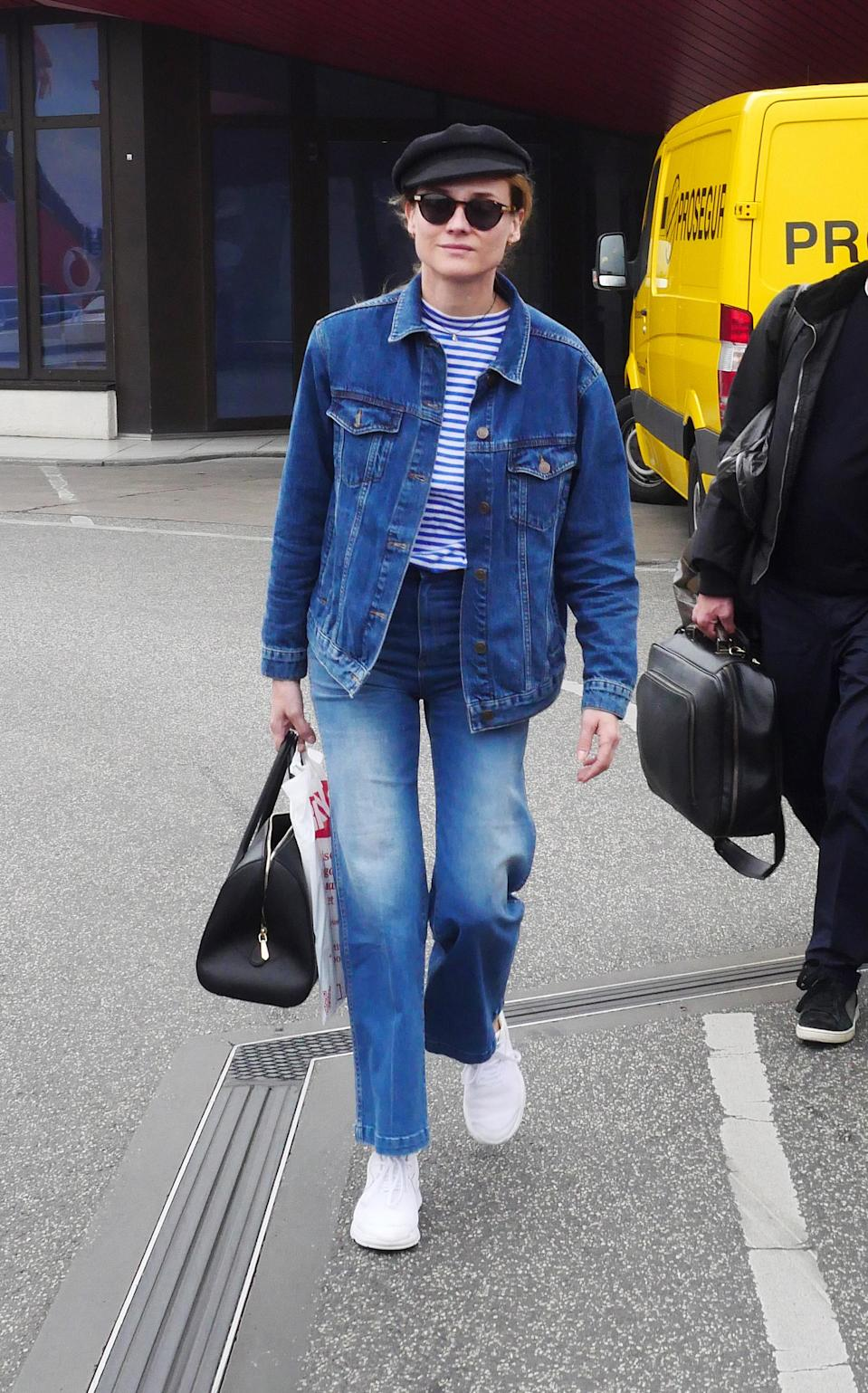 <p>Yup, we're still over here fully appreciating Diane Kruger's effortless airport style. The lesson to take away: Breton tees and denim are a match made in heaven. <em>[Photo: Getty]</em> </p>
