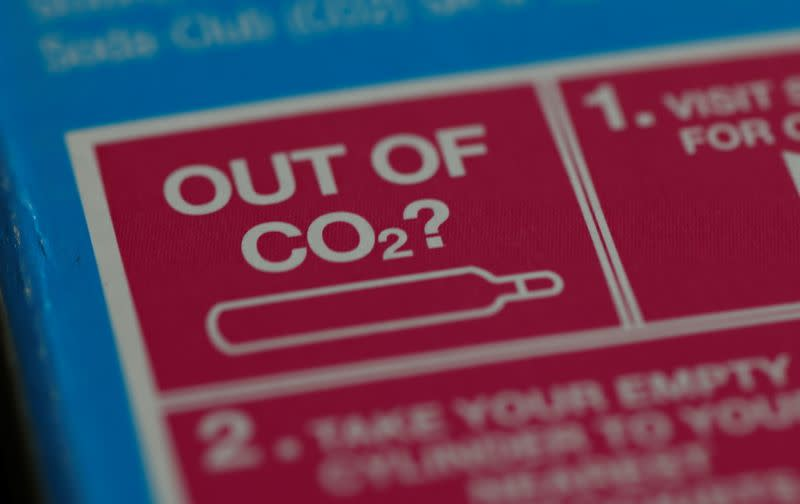 An information label is seen on packaging for a CO2 cylinder for a fizzy drinks machine in Manchester