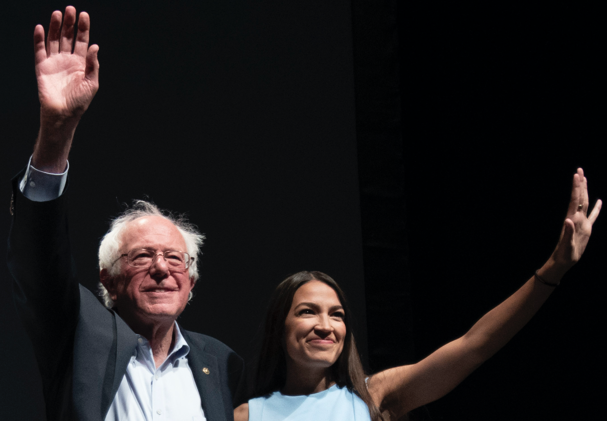 Bernie Sanders and Alexandria Ocasio-Cortez wave to the crowd at the end of a rally in Wichita, Kan., last year. (Photo: J Pat Carter for the Washington Post via Getty)