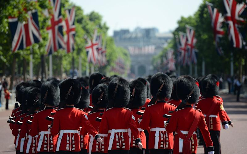 Members of the Coldstream Guards, a regiment of the Household Cavalry, ahead of the Queen's Birthday Parade - Credit: AFP