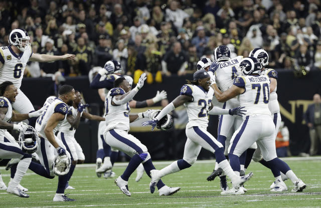 Los Angeles Rams players celebrate after winning the NFC championship. (AP)