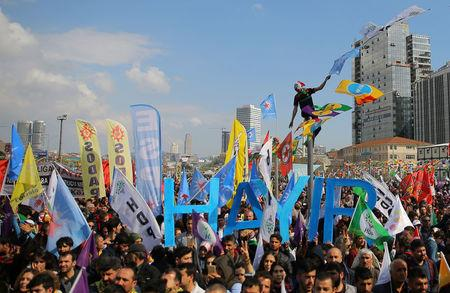 "FILE PHOTO: Pro-Kurdish opposition Peoples' Democratic Party (HDP) and ""Hayir"" (""No"") supporters attend a rally for the upcoming referendum in Istanbul, Turkey, April 8, 2017. REUTERS/Huseyin Aldemir/File Photo"