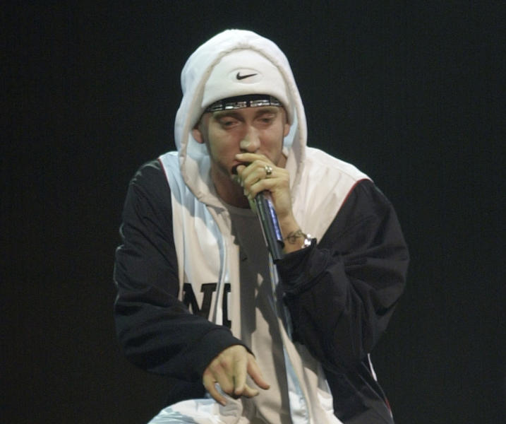 """FILE - In this Nov. 14, 2002, file photo, Eminem performs at the MTV European Music Awards in Sant Jordi palace in Barcelona, Spain. They may not have lost themselves in the music or the moment but a judge and nine lawyers in a New Zealand courtroom did listen politely to Eminem's """"Lose Yourself"""" as a copyright trial involving the country's ruling political party began Monday, May 1, 2017. The Detroit-based music publishers for Eminem are suing New Zealand's conservative National Party for using a similar soundtrack titled """"Eminem Esque"""" for a 2014 TV ad. (AP Photo/Denis Doyle, Pool, File)"""