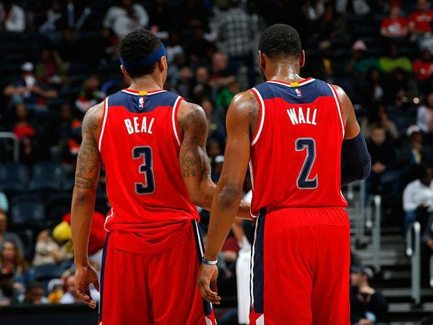 Bradley Beal and John Wall hash it out. (Getty Images)