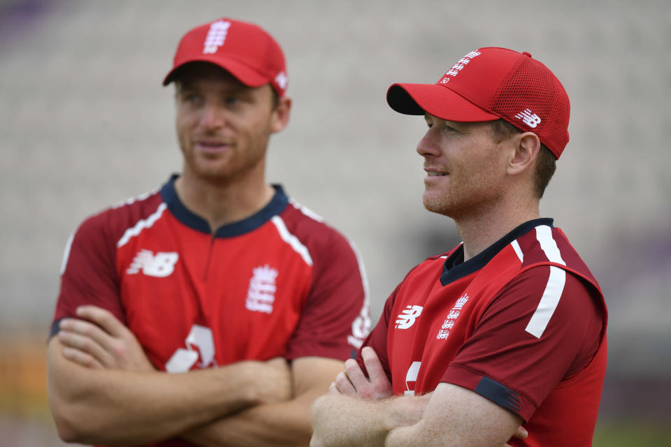 England's captain Eoin Morgan, right, with teammate Jos Buttler after their win in the second Twenty20 cricket match between England and Australia, at the Ageas Bowl in Southampton, England, Sunday, Sept. 6, 2020. (Dan Mullan/Pool via AP)