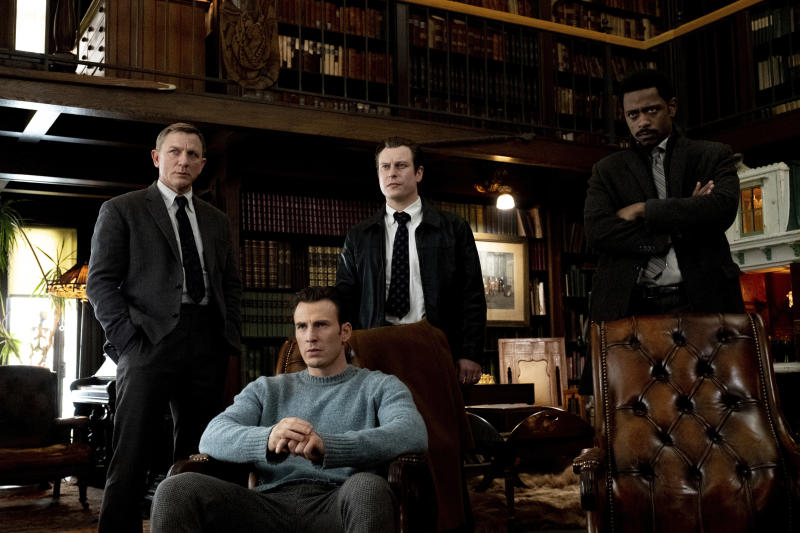 """This image released by Lionsgate shows Daniel Craig, from left, Chris Evans, Noah Segan and Lakeith Stanfield in a scene from """"Knives Out."""" (Claire Folger/Lionsgate via AP)"""