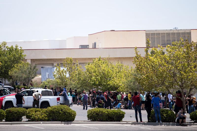 Individuals that were evacuated sit in a parking lot across from a Wal-Mart where a shooting occurred at Cielo Vista Mall in El Paso, Texas, Saturday, Aug. 3, 2019. (Photo: Joel Angel Juarez/AFP/Getty Images)