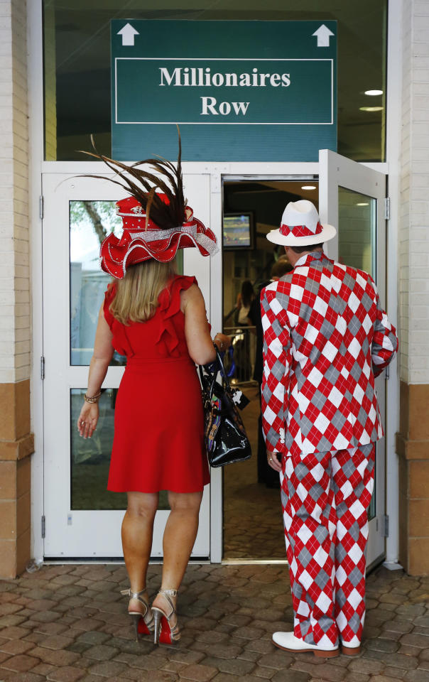 Spectators make their way to the grandstand viewing area before the 138th Kentucky Derby horse race at Churchill Downs, Saturday, May 5, 2012, in Louisville, Ky. (AP Photo/James Crisp)