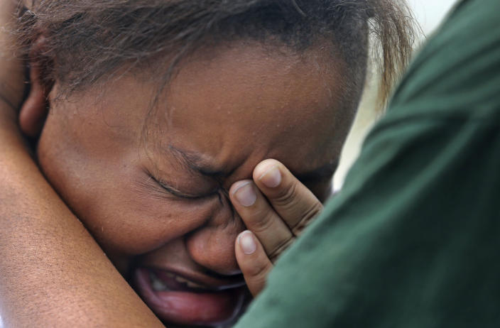 Lisa North, the mother of missing 6-year-old Ahlittia North, cries in the arms of her mother, Rene' Johnson, after she says Jefferson Parish authorities have found the body of her daughter in a Harvey trash bin, in Harvey, La., Tuesday, July 16, 2011. Ahlittia disappeared from her apartment late Friday night or early Saturday morning. North's husband Albert Hill said they were told the body was found in a trash bin not far from their apartment. (AP Photo/Gerald Herbert)