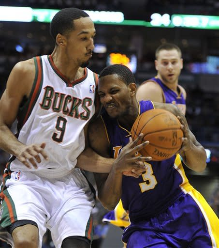 Milwaukee Bucks' Shaun Livingston (9) defends as Los Angeles Lakers' Devin Ebanks (3) drives to the basket during the first half of an NBA basketball game on Saturday, Jan. 28, 2012, in Milwaukee. (AP Photo/Jim Prisching)
