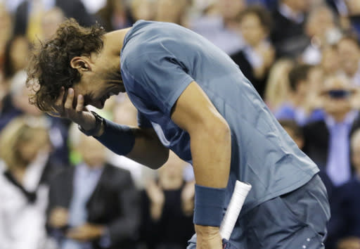 Rafael Nadal, of Spain, reacts after defeating Novak Djokovic, of Serbia, during the men's singles final of the 2013 U.S. Open tennis tournament, Monday, Sept. 9, 2013, in New York. (AP Photo/David Goldman)