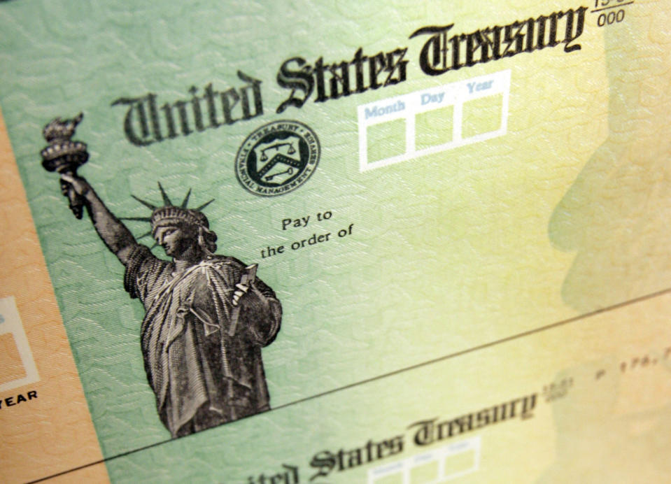 May 8, 2008, file photo shows blank checks on an idle press at the Philadelphia Regional Financial Center, which disburses payments on behalf of federal agencies, in Philadelphia. (AP Photo/Matt Rourke, File)