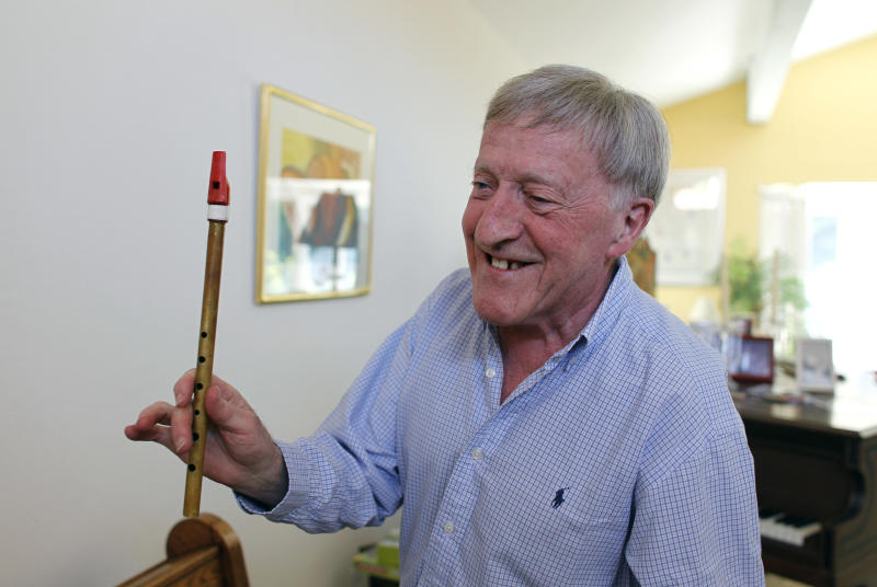 "In this April 2, 2012 photo, Irish musician Paddy Moloney of the Chieftains, holds up a tin whistle at his home in Naples, Fla. Moloney collaborates with musicians, Bon Iver, the Pistol Annies, the Civil Wars, the Secret Sisters, the Carolina Chocolate Drops on The Chieftains' 50th anniversary album, ""Voice of Ages."" (AP Photo/Lynne Sladky)"
