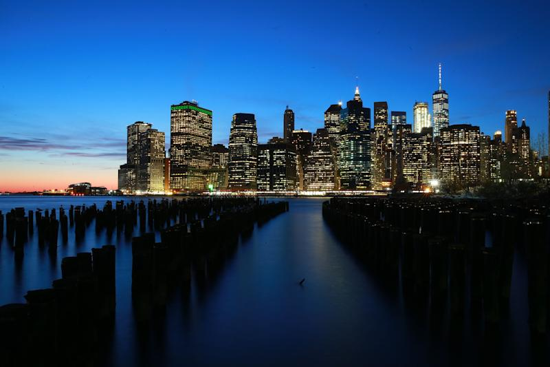 A view of Lower Manhattan from across the East River at the Brooklyn piers at sunset. (Photo: Gordon Donovan/Yahoo News)