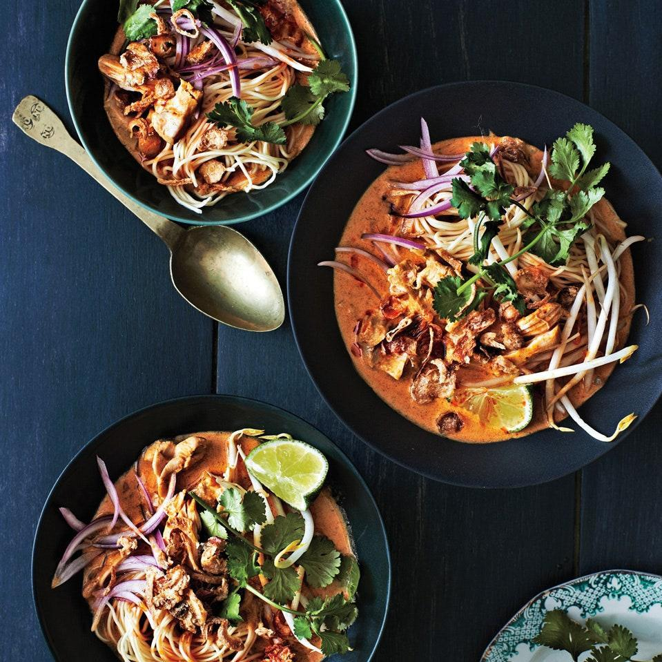 """The roasty flavor of a blend of chiles, shallots, garlic, ginger, cilantro stems, coriander, turmeric, and curry powder gives this Northern <a href=""""https://www.epicurious.com/recipes-menus/thai-food-recipes-gallery?mbid=synd_yahoo_rss"""" rel=""""nofollow noopener"""" target=""""_blank"""" data-ylk=""""slk:Thai-inspired"""" class=""""link rapid-noclick-resp"""">Thai-inspired</a> soup fantastic flavor. Each diner can add their own crunchy toppings, like sliced red onion, bean sprouts, cilantro sprigs, and crispy fried onions or shallots. <a href=""""https://www.epicurious.com/recipes/food/views/chicken-khao-soi-51149110?mbid=synd_yahoo_rss"""" rel=""""nofollow noopener"""" target=""""_blank"""" data-ylk=""""slk:See recipe."""" class=""""link rapid-noclick-resp"""">See recipe.</a>"""
