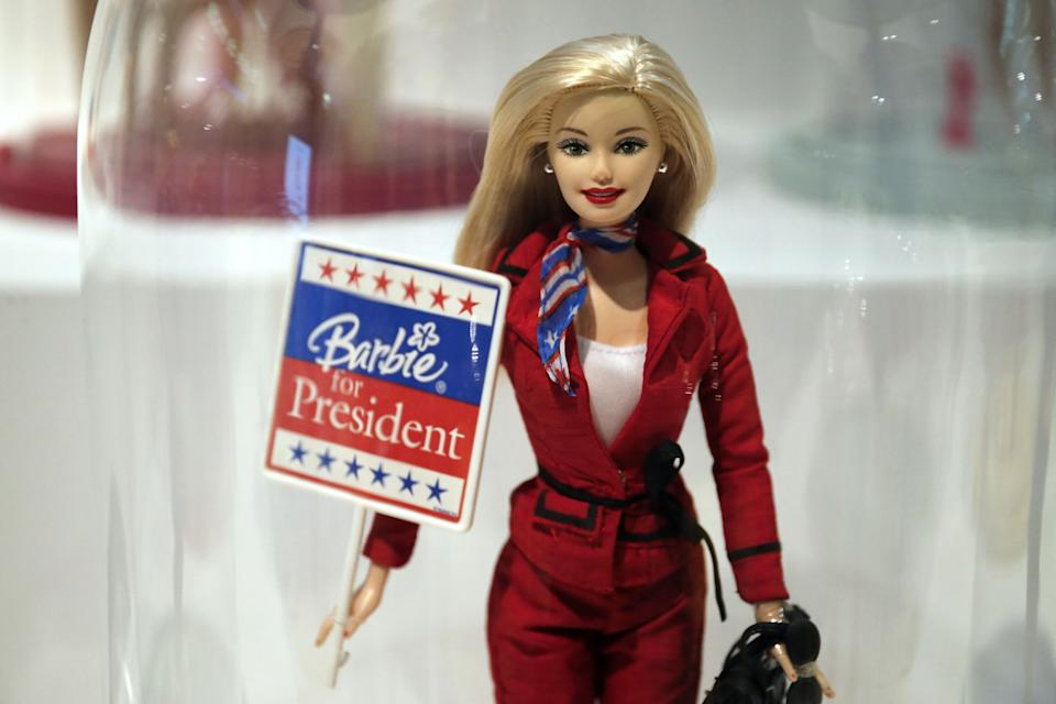 Barbie holding an electoral poster. (Photo: Getty Images)