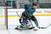 San Jose Sharks center Logan Couture (39) tries to score against Colorado Avalanche goaltender Philipp Grubauer (31) during the first period of an NHL hockey game in San Jose, Calif., on Wednesday, May 5, 2021. (AP Photo/Tony Avelar)