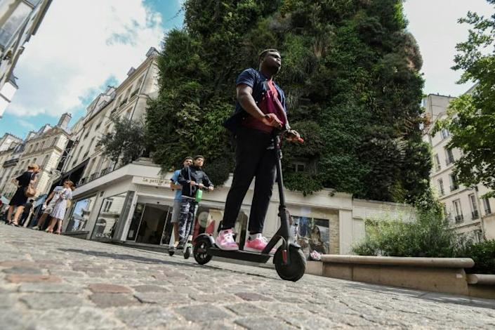 Dozens of scooter companies have flooded Paris's streets (AFP Photo/ALAIN JOCARD)