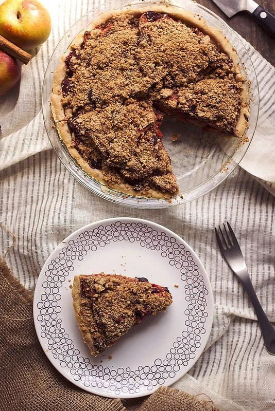 "<p>Complete with a flakey and chewy crust, this tart yet sweet pie is filled to the brim with apples and berries and will melt in your mouth. Serve it hot with a dollop of whipped cream or creamy vanilla ice cream.</p> <p>Get the recipe: <a href=""http://tasty-yummies.com/grain-free-apple-berry-crumb-pie-paleo-with-vegan-and-aip-options/"" class=""link rapid-noclick-resp"" rel=""nofollow noopener"" target=""_blank"" data-ylk=""slk:grain-free apple berry crumb pie"">grain-free apple berry crumb pie</a></p>"