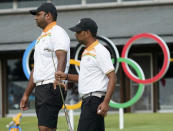 India's Udayan Mane, left, and his teammate Anirban Lahiri at the putting green during a practice session of the men's golf event at the 2020 Summer Olympics, Tuesday, July 27, 2021, at the Kasumigaseki Country Club in Kawagoe, Japan, (AP Photo/Matt York)