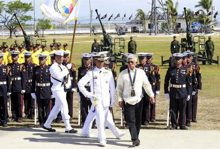 Philippine Defense Secretary Voltaire Gazmin (R) reviews the honor guards upon his arrival to lead the 117th Philippine Navy anniversary held inside the Naval station in Pascual Ledesma, Fort San Felipe, Cavite City, south of Manila May 25, 2015. REUTERS/Romeo Ranoco