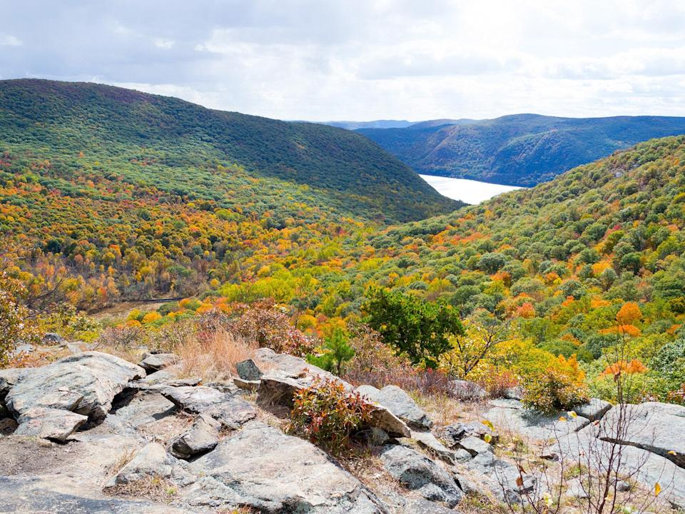 """Thanks to the trailhead being close to its namesake Metro-North railroad stop, the three-mile Breakneck Ridge loop attracts a <a href=""""https://www.cntraveler.com/destinations/new-york-city?mbid=synd_yahoo_rss"""" rel=""""nofollow noopener"""" target=""""_blank"""" data-ylk=""""slk:New York City"""" class=""""link rapid-noclick-resp"""">New York City</a> crowd itching for an easy, car-free escape. But the steep, strenuous hike is one of the most common in the Northeast for more reasons than just its accessibility: Strategic rock scrambling is rewarded with panoramic views of the Hudson River Valley."""