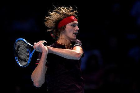 FILE PHOTO: Tennis - ATP World Tour Finals - The O2 Arena, London, Britain, November 14, 2017. Germany's Alexander Zverev in action during his group stage match against Switzerland's Roger Federer. Action Images via Reuters/Tony O'Brien/File Photo
