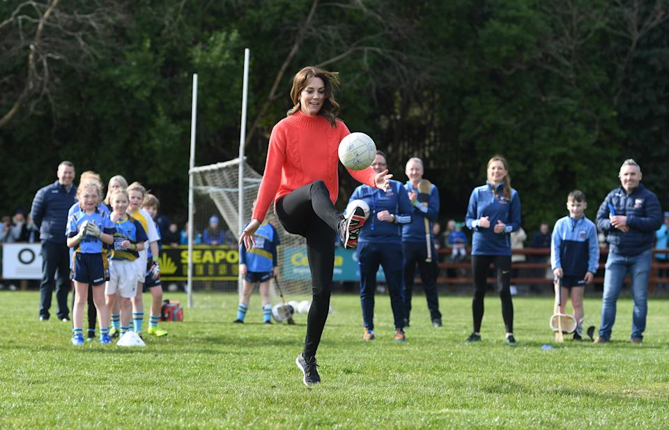 GALWAY, IRELAND - MARCH 05: Catherine, Duchess of Cambridge tries her hand at Gaelic Football as part of her visit to Salthill Knocknacarra GAA Club in Galway on March 5, 2020 in Galway, Ireland. (Photo by Facundo Arrizabalaga - Pool/Getty Images)
