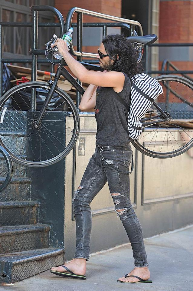 """While in the Big Apple shooting the upcoming film, """"The Dictator,"""" a distressed-denim-clad Russell Brand prepared himself for a bike ride through Manhattan on Thursday, which, as any New Yorker can tell you, can be quite a risky adventure! JosiahW/<a href=""""http://www.splashnewsonline.com"""" target=""""new"""">Splash News</a> - June 30, 2011"""
