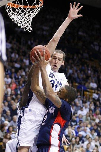 Gonzaga's Marquise Carter, right, is founded by BYU's Noah Hartsock as he goes up for a shot during the first half of an NCAA college basketball game in Provo, Utah, Thursday, Feb. 2, 2012. (AP Photo/George Frey)