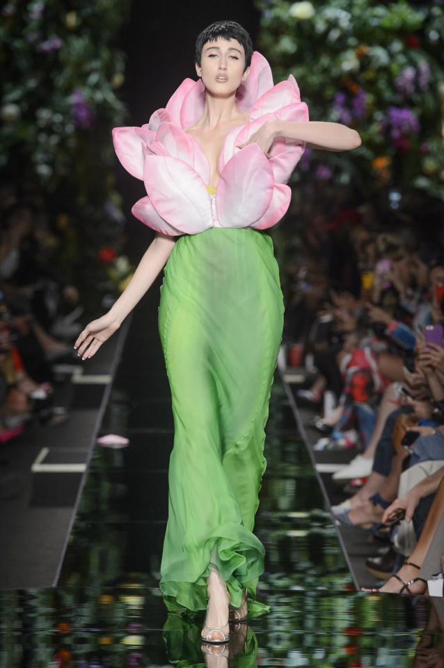 <p>Anna Cleveland wears a pink petal bodice and green dress from the SS18 Moschino collection. (Photo: ImaxTree) </p>