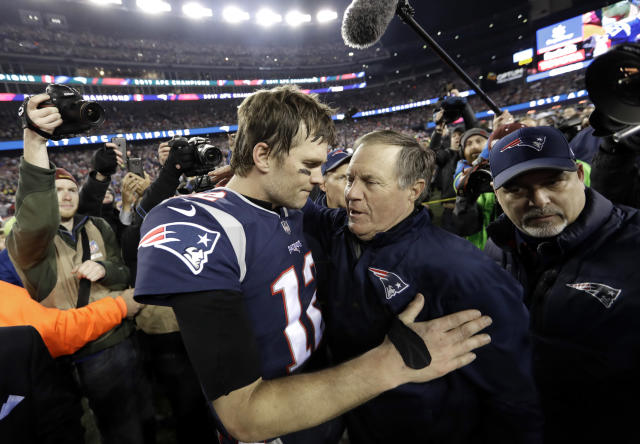 FILE - In this Jan. 21, 2018, file photo, New England Patriots quarterback Tom Brady, left, hugs coach Bill Belichick after the AFC championship NFL football game against the Jacksonville Jaguars, in Foxborough, Mass. While the Patriots appear to be vulnerable in several areas _ tension between Brady and Belichick could be the biggest threat to the dynasty _ there still doesnt seem to be anybody ready to knock them off the postseason podium. (AP Photo/David J. Phillip, File)
