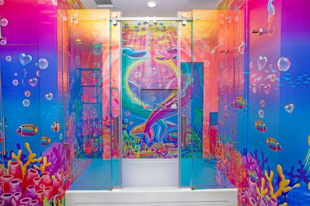 PHOTO: Guests can shower in a bathroom covered in the classic Lisa Frank dolphins. (via Hotels.com)