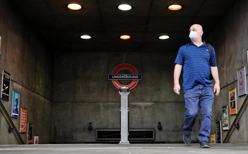 A man with a face mask exits the nearly empty Westminster tube station in London, Monday, April 27, 2020. While Britain is still in lockdown, some Nations have begun gradually easing coronavirus lockdowns, each pursuing its own approach but all with a common goal in mind, restarting their economies without triggering a new wave of infections.(AP Photo/Frank Augstein)