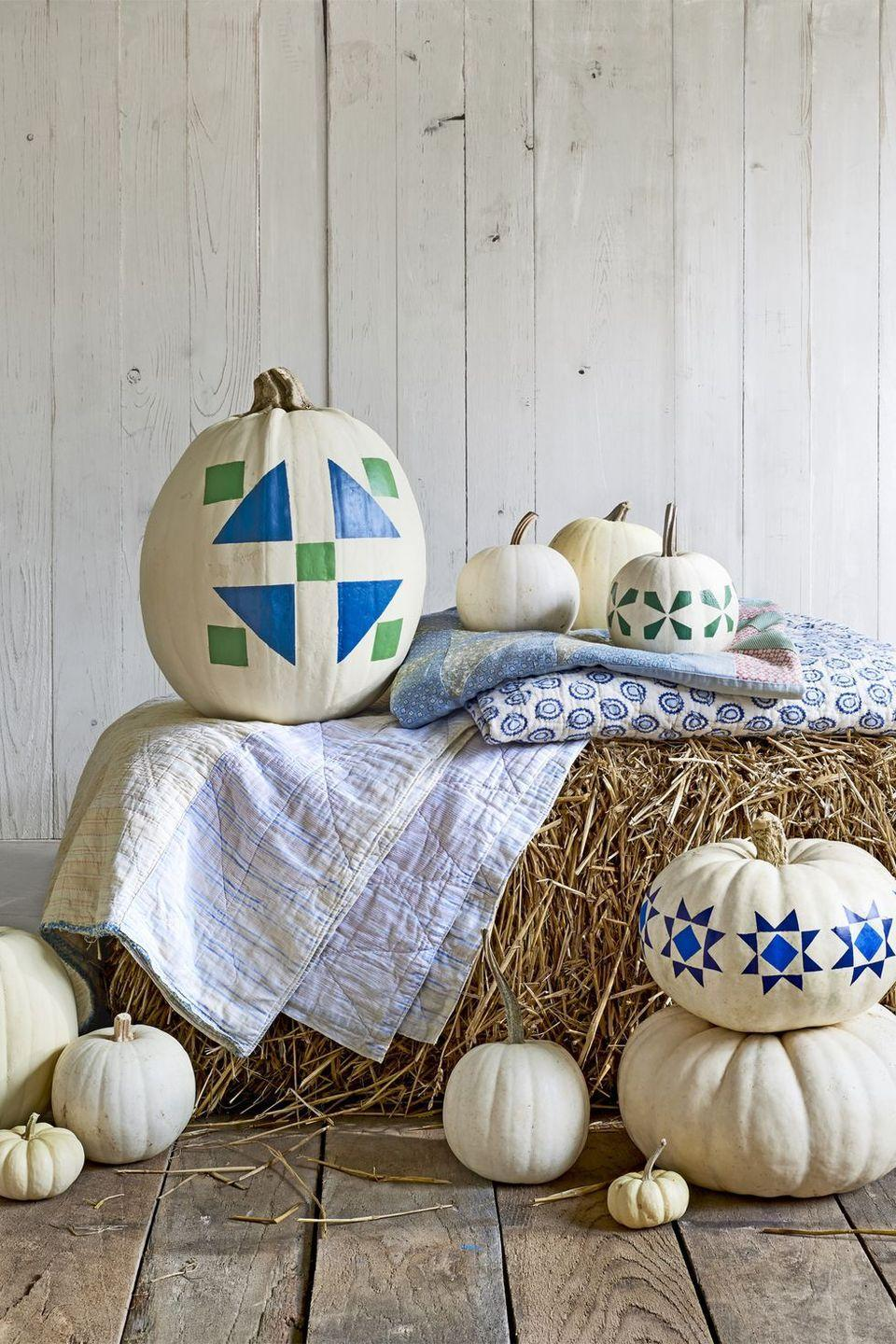"""<p>There's no rule that you have to have scary pumpkins for Halloween. Paint some beautiful quilt-inspired designs instead! </p><p><strong><em>Get the tutorial at <a href=""""https://www.countryliving.com/diy-crafts/g1350/pumpkin-decorating-1009/"""" rel=""""nofollow noopener"""" target=""""_blank"""" data-ylk=""""slk:Country Living."""" class=""""link rapid-noclick-resp"""">Country Living.</a> </em></strong></p>"""