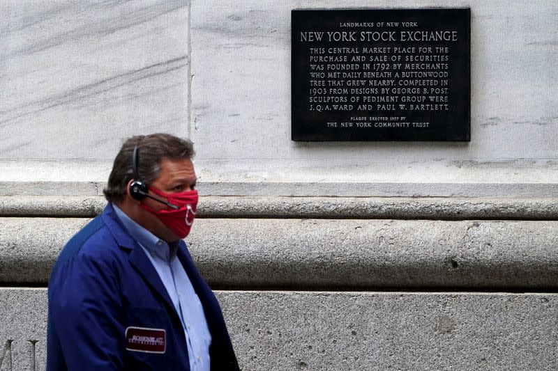 A trader is seen outside the New York Stock Exchange in the Manhattan borough of New York City