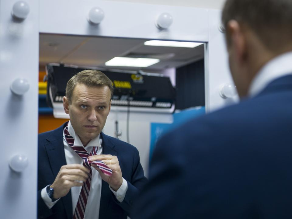FILE - In this Dec. 18, 2017, file photo, Russian opposition politician Alexei Navalny prepares himself prior his interview with The Associated Press in Moscow, Russia. The return of Navalny on Jan. 17, 2021, from Germany after he spent five months in Berlin recovering from a nerve agent poisoning was marked by chaos and popular outrage, and it ended, almost predictably with his arrest. (AP Photo/Alexander Zemlianichenko, File)