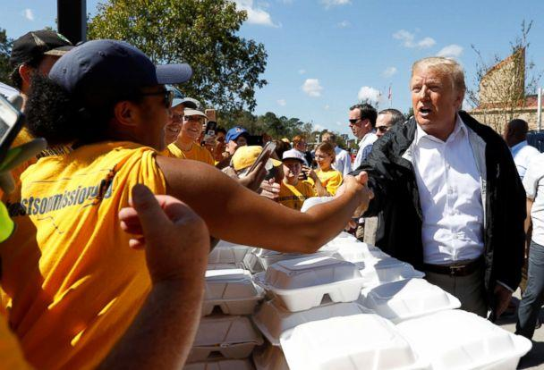 PHOTO: President Donald Trump greets people while distributing food after Hurricane Florence in New Bern, N.C., Sept. 19, 2018. (Kevin Lamarque/Reuters)