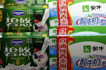 Yogurt products of Danoe and Mengniu are displayed at a supermarket in Beijing
