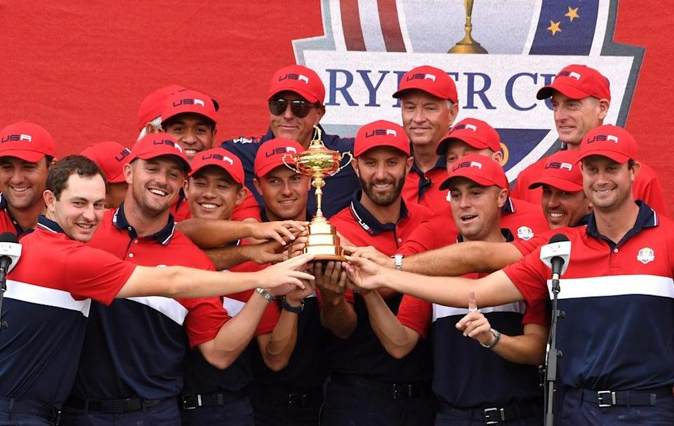 Team USA team celebrate with the Ryder Cup trophy after thrashing Europe 19-9 at Whistling Straits (Anthony Behar/PA) (PA Wire)
