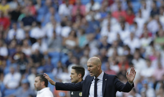 Real Madrid's head coach Zinedine Zidane gestures during the Spanish La Liga soccer match between Real Madrid and Valladolid at the Santiago Bernabeu stadium in Madrid, Spain, Saturday, Aug. 24, 2019. (AP Photo/Paul White)