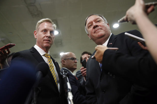 Acting Defense Secretary Patrick Shanahan, left, and Secretary of State Mike Pompeo speak to members of the media after a classified briefing for members of Congress on Iran, Tuesday, May 21, 2019, on Capitol Hill in Washington. (AP Photo/Patrick Semansky)