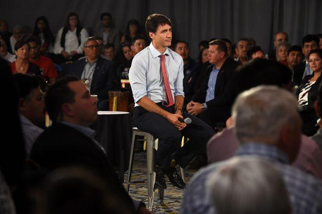 Liberal Leader Justin Trudeau listens to a question at a campaign rally in Saskatoon on Sept. 19, 2019.