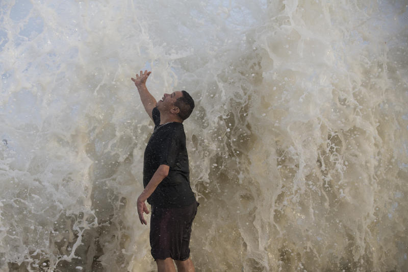 Water falls over Jimmy Villarreal, of Galveston, Texas as a wave hits the seawall while he was watching the surf stirred up by Hurricane Laura on Wednesday. Source: AP