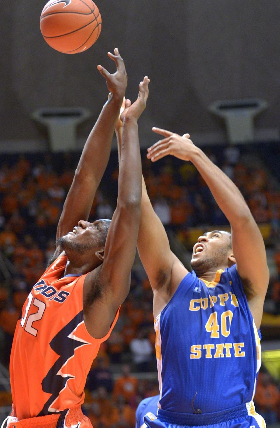 Illinois' forward/center Nnanna Egwu (32) and Coppin State's forward Brandon St. Louis (40) go up for a rebound during an NCAA college basketball game in Champaign, Ill., on Sunday, Nov. 16, 2014. (AP Photo/Robin Scholz)
