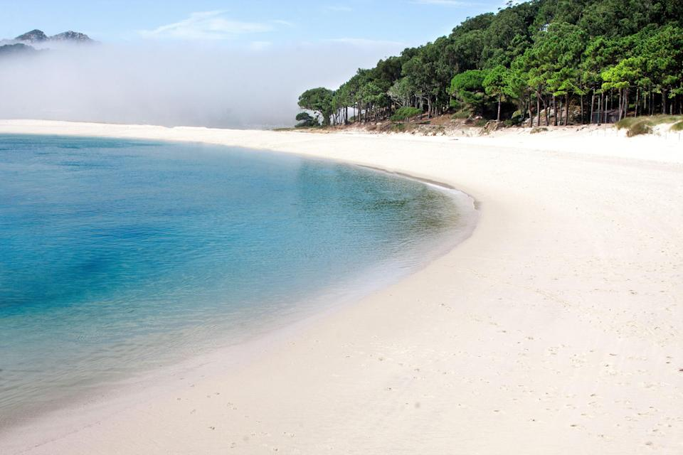"""Spain's most pristine <a href=""""https://www.cntraveler.com/gallery/spains-secret-islands?mbid=synd_yahoo_rss"""" rel=""""nofollow noopener"""" target=""""_blank"""" data-ylk=""""slk:white-sand beaches"""" class=""""link rapid-noclick-resp"""">white-sand beaches</a> aren't found along the Mediterranean, but in the northwesterly region of Galicia. Here lie the Islas Cíes, a three-island nature reserve with just three year-round inhabitants. Call the Cíes the Spanish Galápagos: There are no hotels, restaurants, or cars in sight—just swooping seabirds, mossy slopes, and lapping waves. Though most visitors come only for the day, outdoorsy types shouldn't pass up camping on the dunes."""