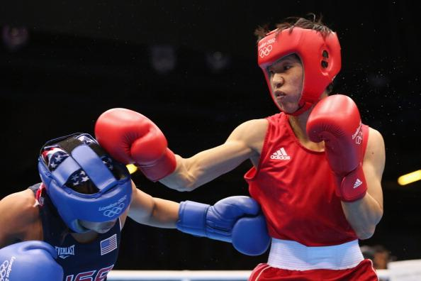 LONDON, ENGLAND - AUGUST 08:  Cancan Ren (R) of China in action with Marlen Esparza of the United States during the Women's Fly (51kg) Boxing on Day 12 of the London 2012 Olympic Games at ExCeL on August 8, 2012 in London, England.  (Photo by Scott Heavey/Getty Images)