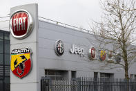 Logos of car companies are seen on the facade of the building housing Stellantis headquarters in Lijnden, near Amsterdam, Netherlands, Monday, Jan. 18, 2021. Stellantis, the car company combining PSA Peugeot and Fiat Chrysler, was launched Monday on the Milan and Paris stock exchanges, giving life to the fourth-largest car company in the world. (AP Photo/Peter Dejong)