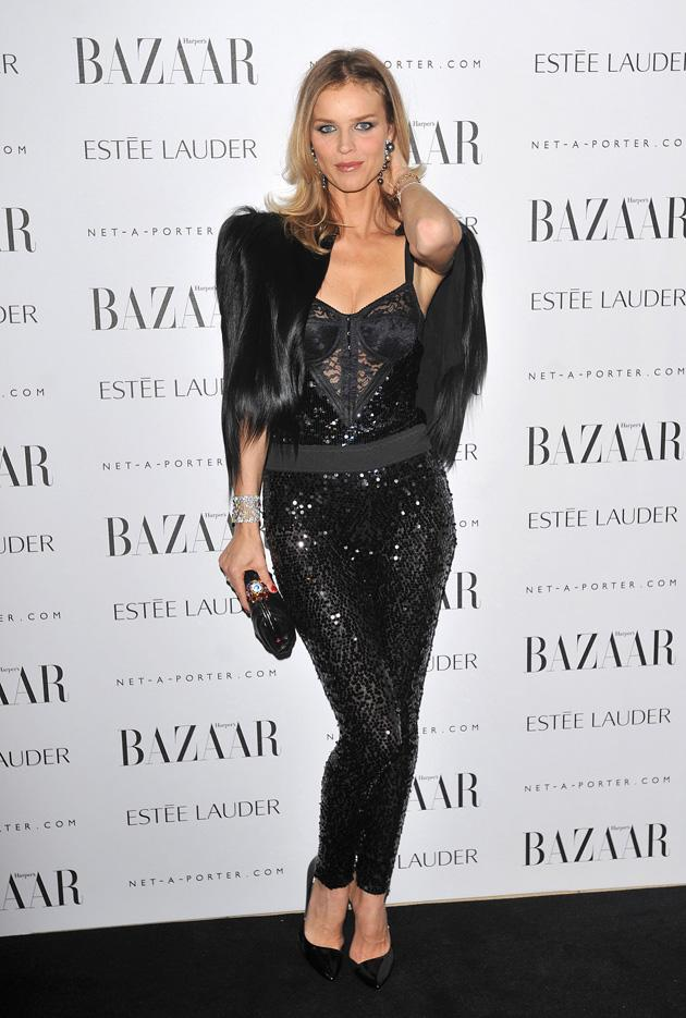 Eva Herzigova went for all kinds of materials to liven up for black outfit.